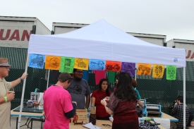One of the vendors, screen printing shirts using hand-carved woodblocks